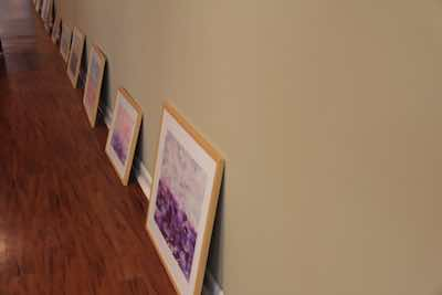 Paintings leaning against wall