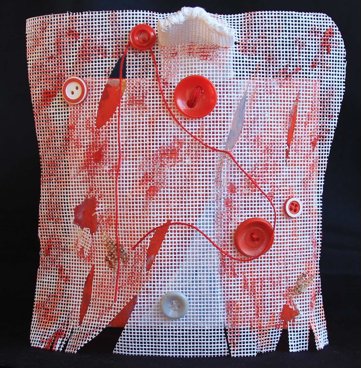 Mixed media red and white painting on needlepoint canvas and stretched canvas with red buttons and thread